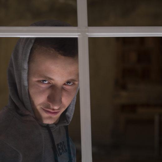 A man behind a window_2