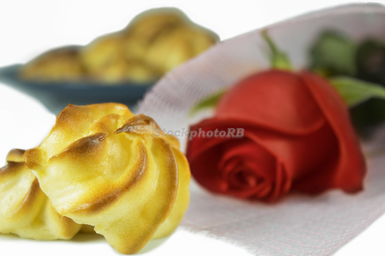 Cream puff pastry and red rose