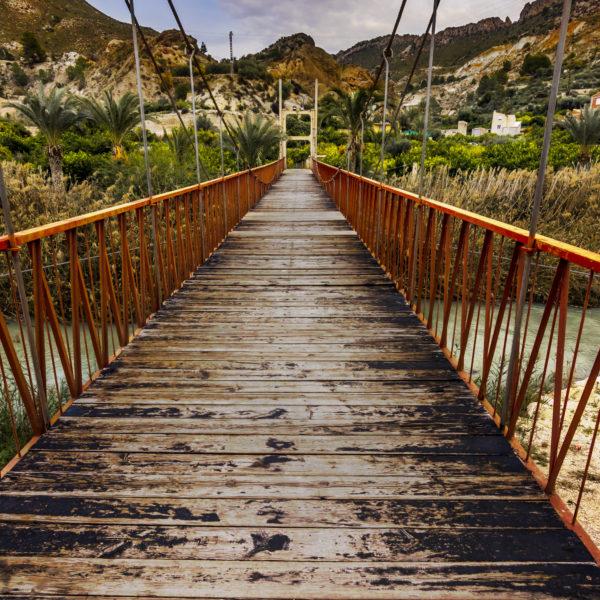 Hanging bridge over a mountain river