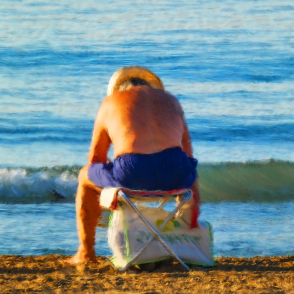 Old man on the beach